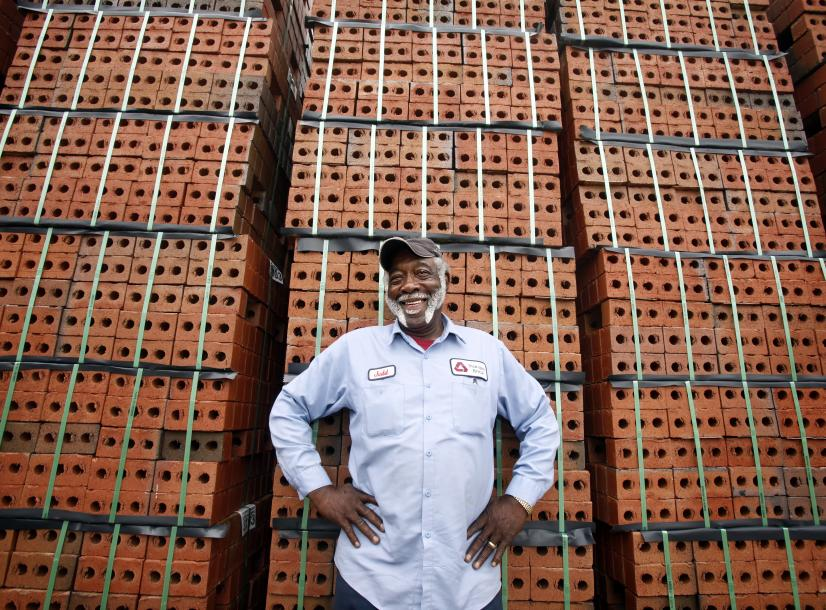 Man standing in front of pallets of brick